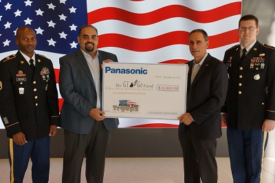 Panasonic CFO & Treasurer Mike Riccio (2nd from right) is joined by members of the Newark Recruiting Company as he presents a check of $9,000 to GI Go Fund Executive Director Jack Fanous