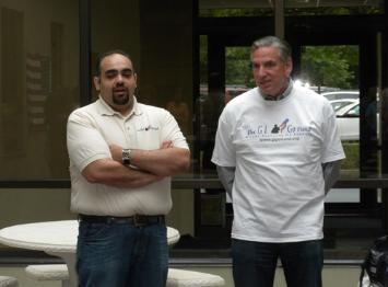 """GI Go Executive Director Jack Fanous with Stephen Grossman, the NE Regional President and CEO of Marsh & McClennan wearing jeans to  support our military at a company event recognizing """"Jeans for Troops"""" day"""
