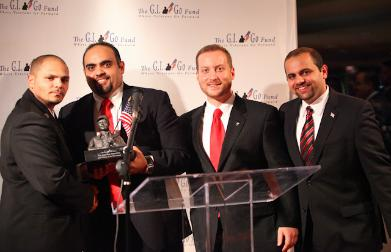 "Army Spec. Jeans Cruz (left), the Iraq War Veteran who found Saddam Hussein hiding in a hole, presented with the ""Veteran of the Year"" Award by Jack Fanous, Deputy Director Alexander Manis, and Director of Communications James Fanous"