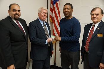 GI Go Executive Director Jack Fanous hands out a $50 Visa Gift Card with Brick Mayor John Ducey and VFW Post 8867 Post Commander Jack Russell.