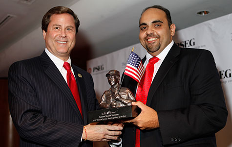 "NJ State Senator Donald Norcross (left) receives 2013 ""Veteran Strong"" Legislator of the Year Award from GI Go Executive Director Jack Fanous at the GI Go Fund Veterans Day Gala."