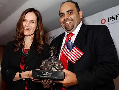 "PSEG's Diana Drysdale (left) receives the 2013 ""Veterans Strong"" Person of the Year Award from GI Go Executive Director Jack Fanous."