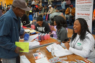 A homeless veteran obtains legal assistance and support from Tonya Tucker of Newark Community Solutions at the annual Stand Down of North Jersey.