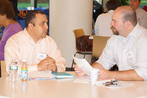 Isaac Trinidad (l), a Navy and Air Force veteran, receives employment tips from Sean Cavanaugh (r), an Army vet who was hired at Johnson & Johnson after attending a GI Go Fund Job Fair in 2011.