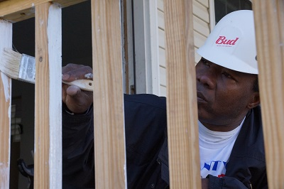 Army Veteran Isaac Ezirim working on his new home from Habitat for Humanity
