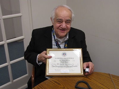 Col. (Ret) David Parano with award recognizing his service in the US Senate