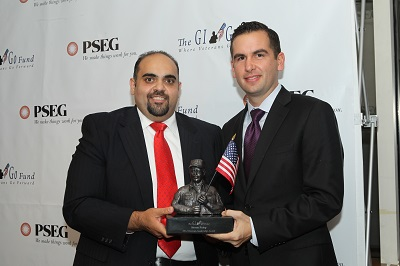 Jersey City Mayor Steven Fulop (left) receives the 2014 Veteran Leadership Award from GI Go Executive Director Jack Fanous during Veterans Day Gala