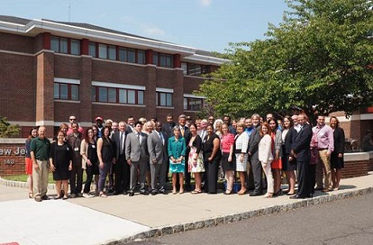 Participants in the Mayors Challenge convening day-long event gather for a group photo. HUD, VA officials, New Jersey mayors, advocates and non-profits work to end veteran homelessness in 2015.