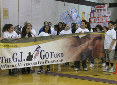 "Students at the Carl Sandburg Middle School in Old Bridge, NJ participate in the ""Step for Vets"" charity walk-a-thon to benefit the GI Go Fund and the vets they serve"