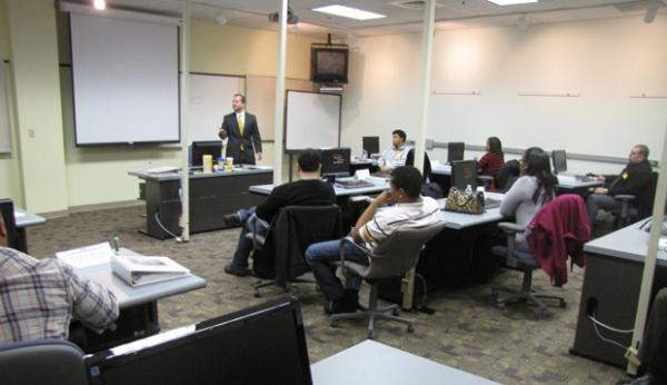 GI Go Fund Deputy Director Alex Manis addresses group of disabled veterans learning the skills that will enable them to become full time at-home customer service call center representatives for PSEG, thanks to a grant from the Kessler Foundation.